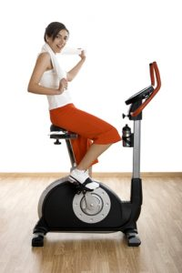 Upright exercise bike in use